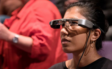 Woman wearing epson's smart glasses