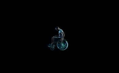 Man in wheelchair on black background