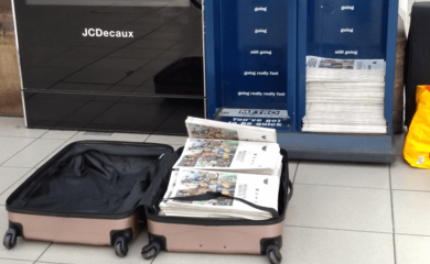 Metro newspapers in a suitcase