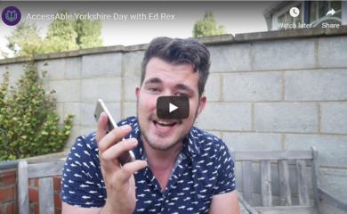 Ed Rex holding phone
