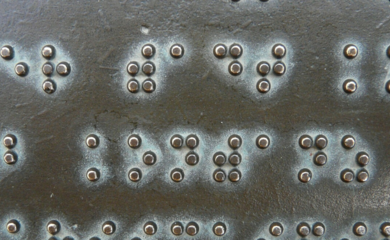 Braille on bronze plaque