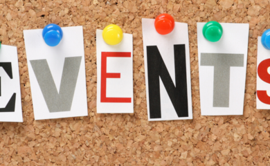 Close up image of cork board, with the word 'events' spelled out in individual capital letters