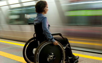 Woman in wheelchair on underground platform