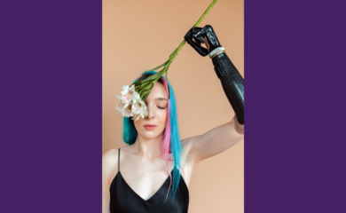 Woman with prosthetic arm holding flower