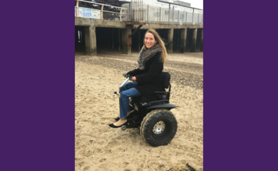 Helen Dolphin using an off road wheelchair on the sand