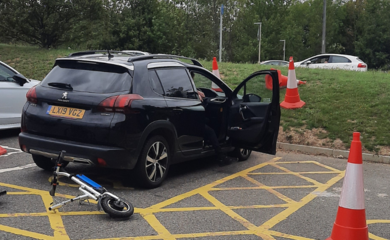 Car in blue badge parking space