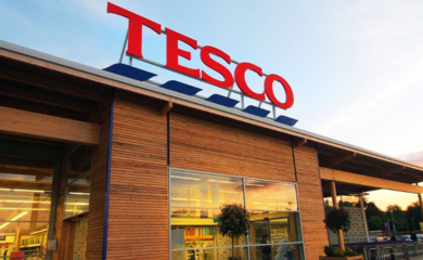 Tesco store front against blue sky