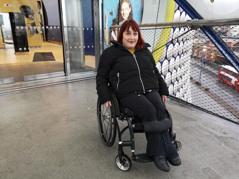 Woman in wheelchair with red hair