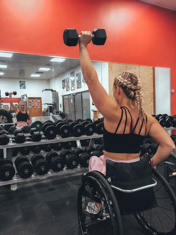 Sophie lifting weights in the gym