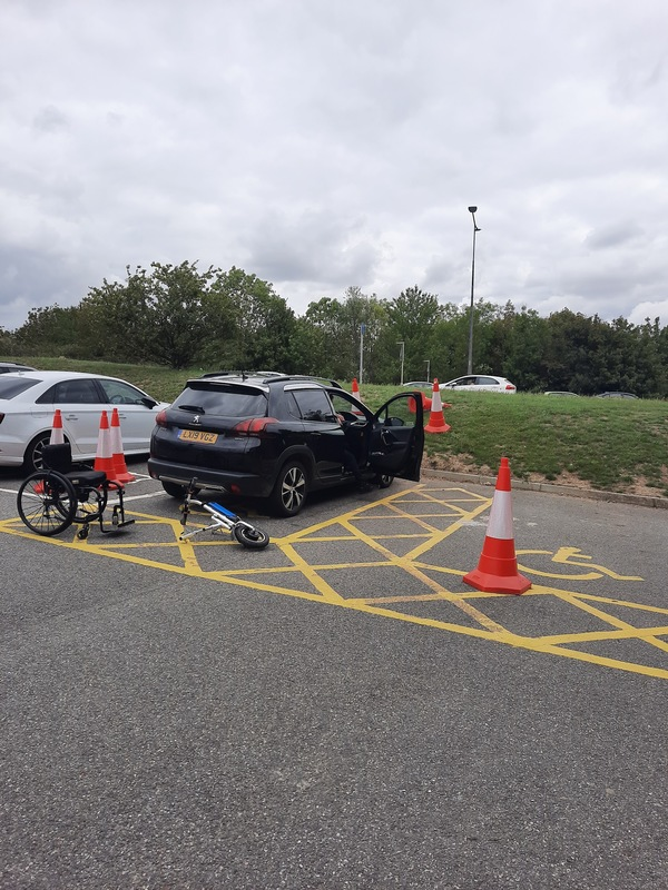 Blue badge parking bays blocked off with cones