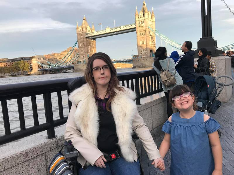 Fi Anderson and her daughter sitting by tower bridge