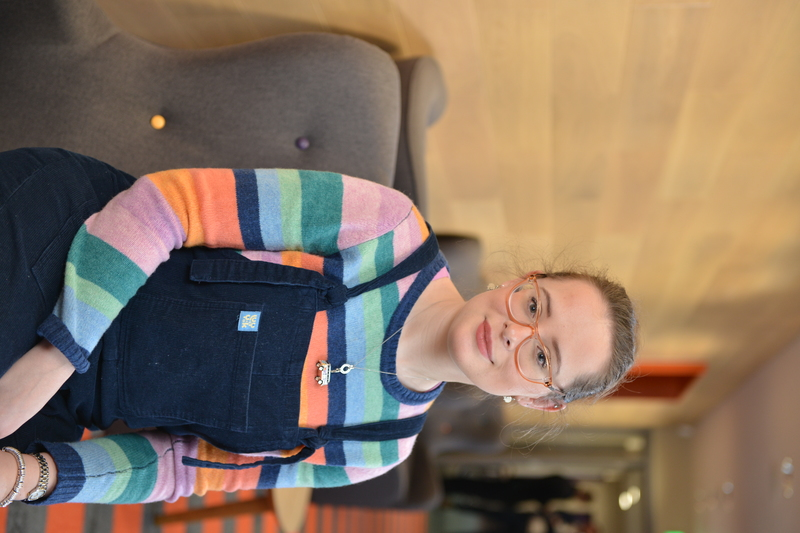 Heather Lacey wearing a stripy jumper and dungarees