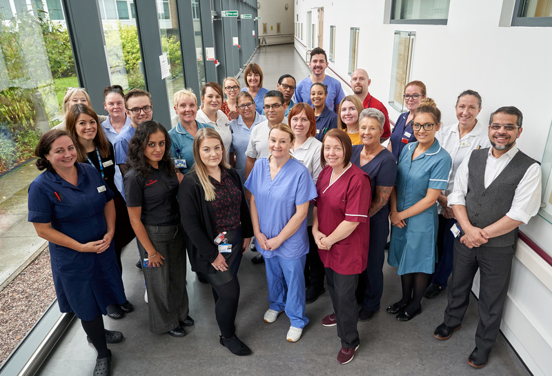 A group of hospital staff in a corridor