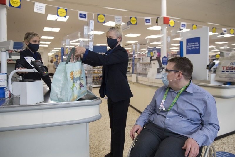 Tesco colleagues and customer wearing masks in store
